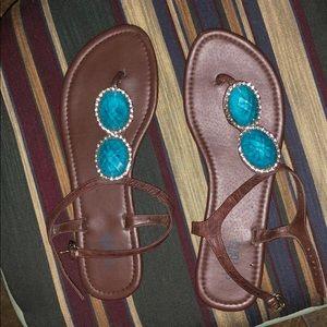 Cute brown flat sandals.